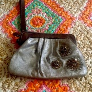 Fossil leather and suede wristlet  floral beading